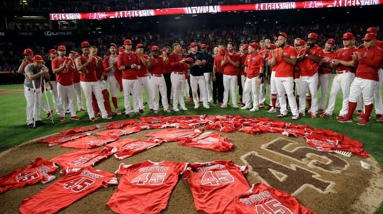 Members of the Los Angeles Angels place their