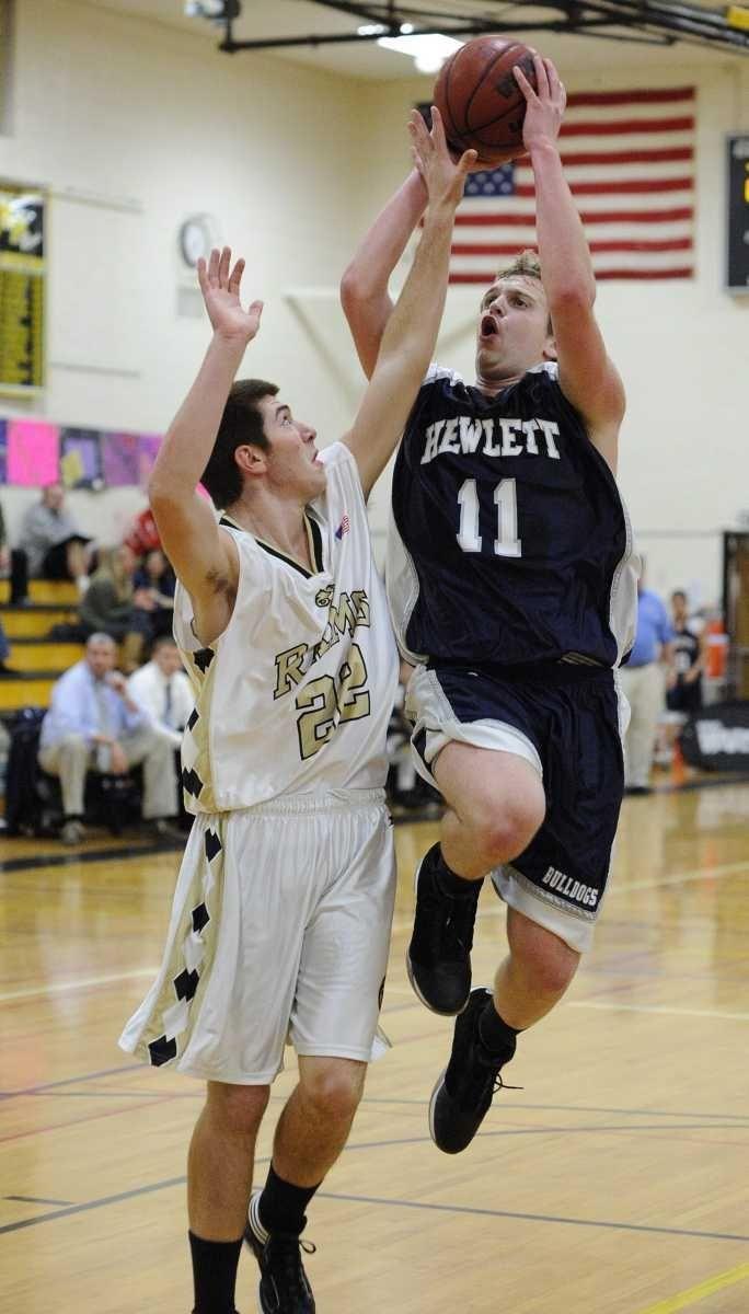 Hewlett's Avery Feldman attempts a shot past West