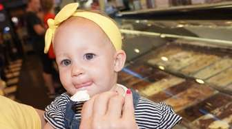 Lucia Cimino of Holbrook ,15 months, samples vanilla