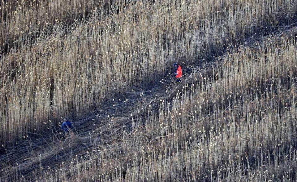 December 9, 2011-AERIAL PHOTO- Investigators continue their search