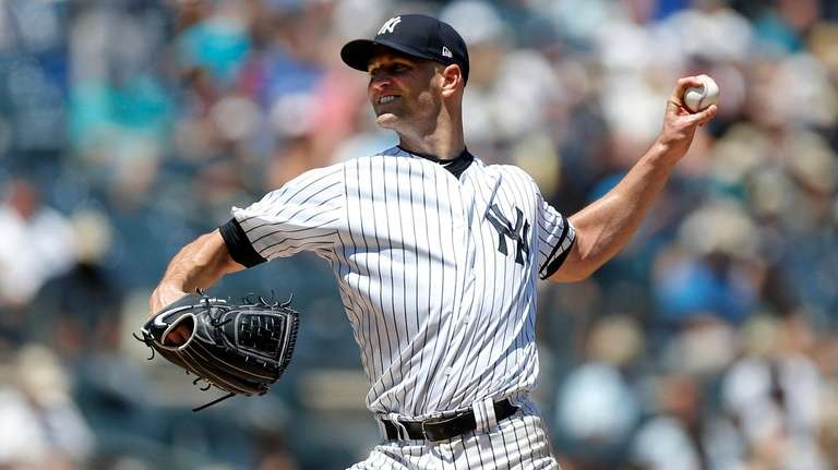 J.A. Happ of the New York Yankees pitches