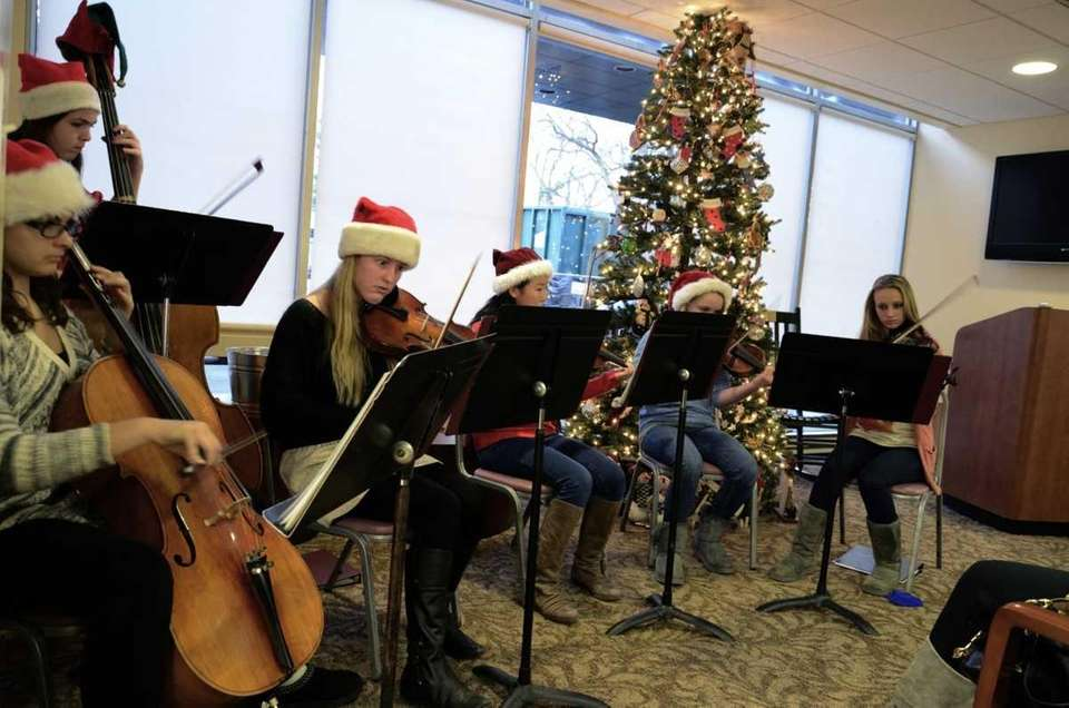 The North Shore High School Orchestra plays holiday