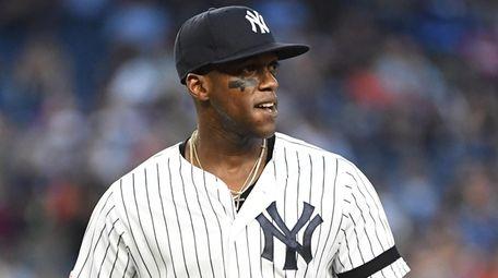Yankees leftfielder Cameron Maybin looks on against the