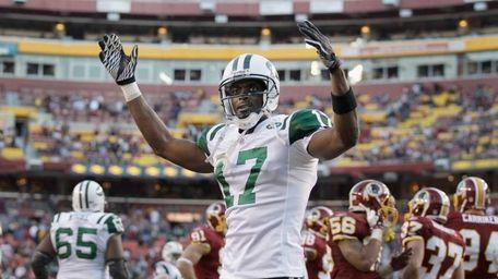 Plaxico Burress of the New York Jets celebrates
