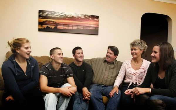 From left: Samantha Mochamer, 20, Shaun, 18, Dan,