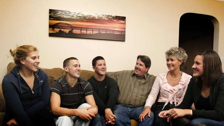 From left: Samantha Mochamer, 20, Shaun, 18, Dan,