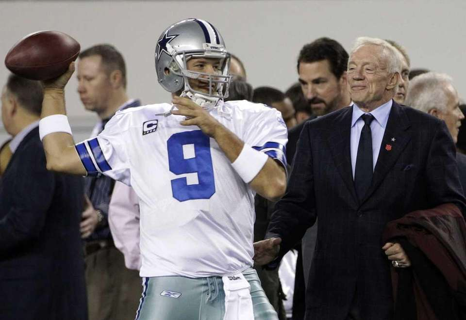 Dallas Cowboys owner Jerry Jones, right, watches as