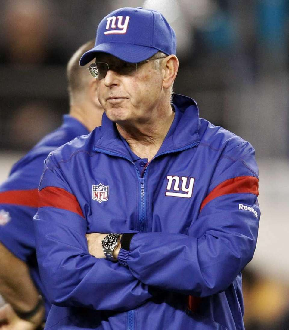 New York Giants head coach Tom Coughlin watches