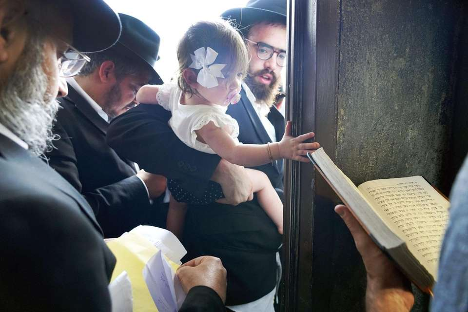 Praying at the grave of the Lubavitcher Rebbe,