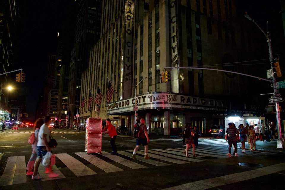 Pedestrians walk near Radio City Music Hall. A