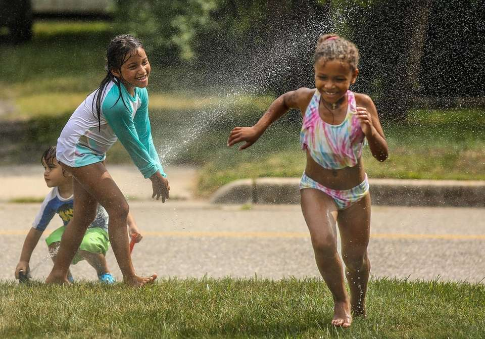 On a hot afternoon, Demi Henthorne, 6, left,