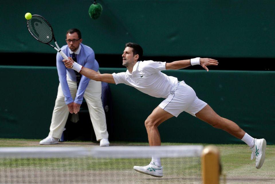 Serbia's Novak Djokovic reaches for the ball to