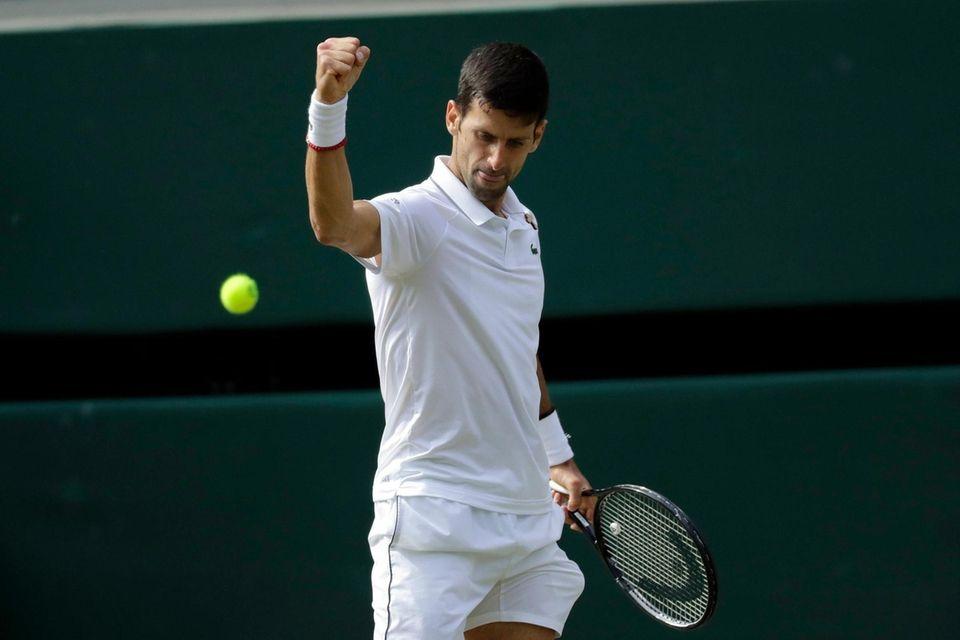 Serbia's Novak Djokovic reacts after scoring a point