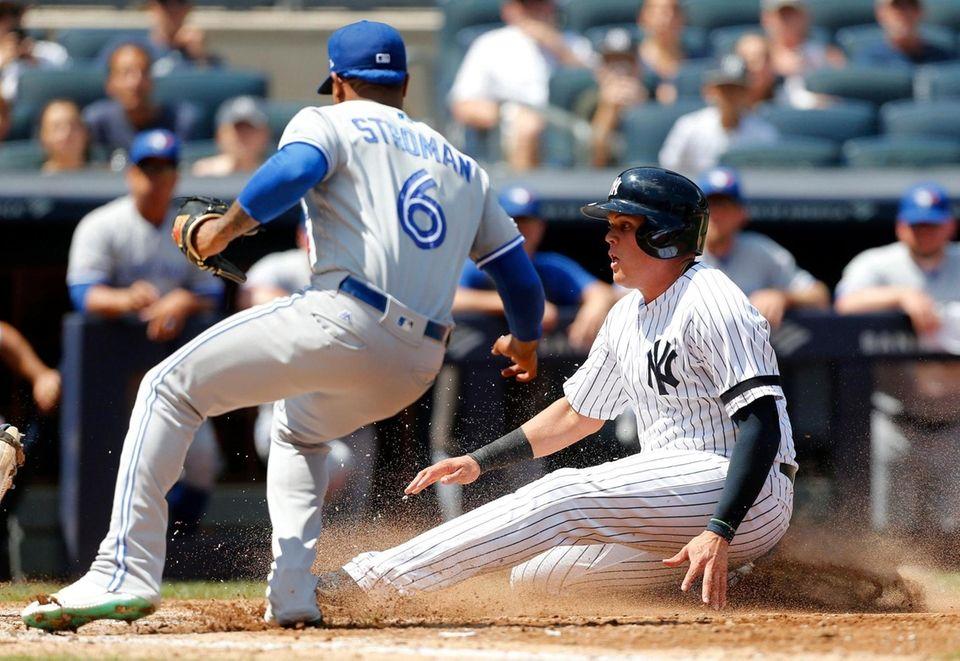 Yankees third baseman Gio Urshela scores a run