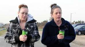 Melissa Cann, left, sister of Maureen Brainard-Barnes, and