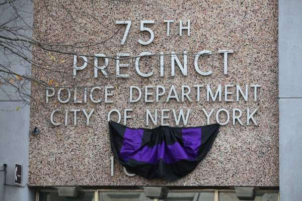Bunting hangs outside the 75th precinct in honor