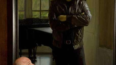 Billy Joel looks at his portrait at its