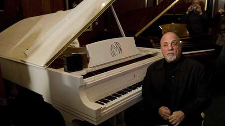 Billy Joel at the unveiling of his Steinway