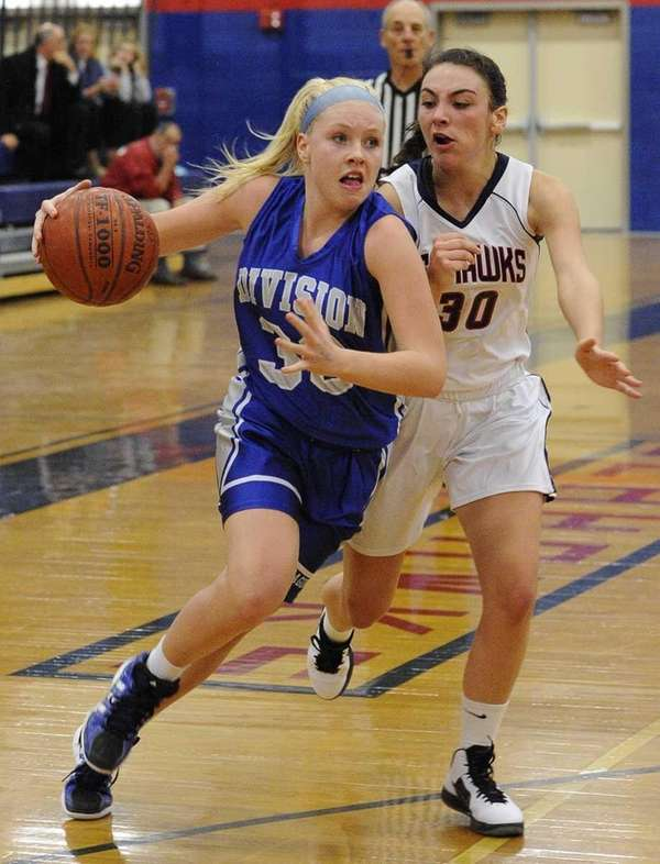 Division's Laura Stuart drives past Cold Spring Harbor's