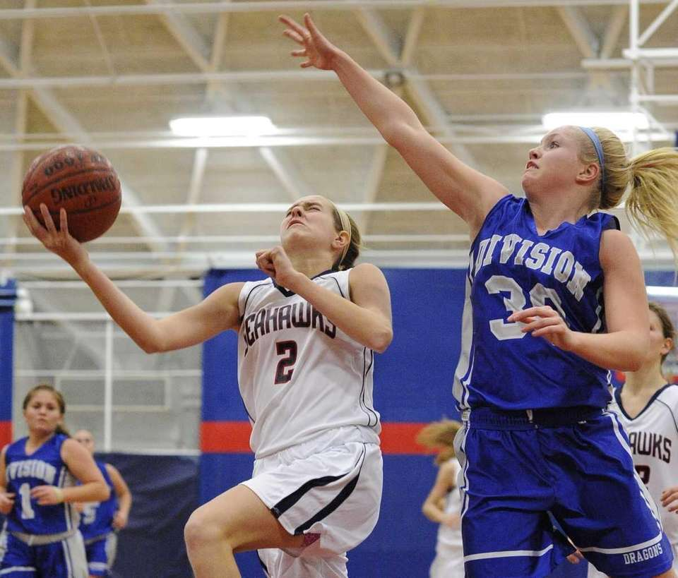 Cold Spring Harbor's Tara Atkinson goes up for