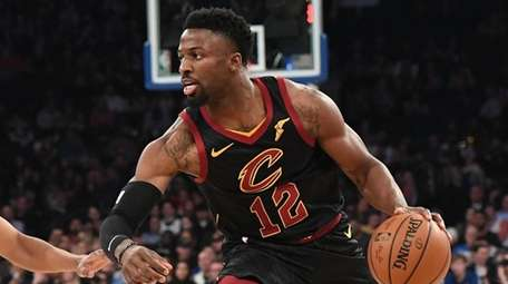 Cleveland Cavaliers guard David Nwaba is defended by