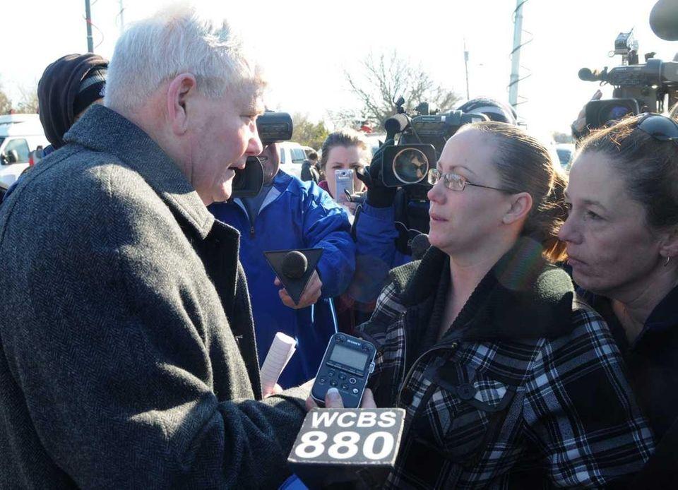 Poilce Commissioner Richard Dormer, left, talks to Lorraine