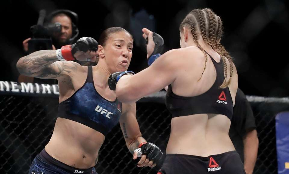 Germaine de Randamie, left, punches Aspen Ladd during