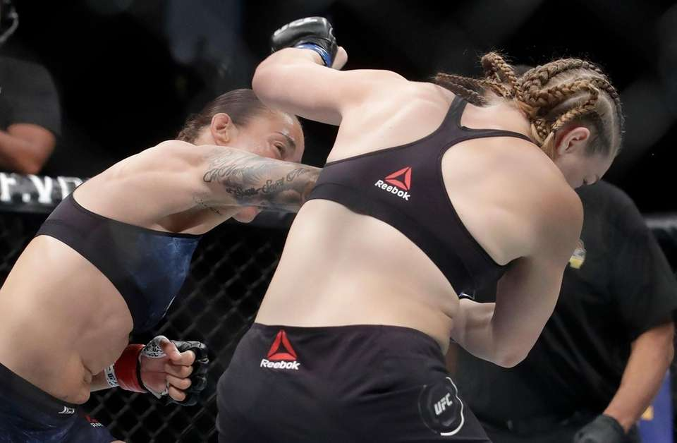 Germaine de Randamie, left, connects with a punch