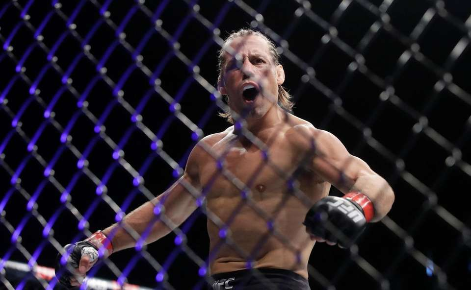 Urijah Faber celebrates after defeating Ricky Simon during