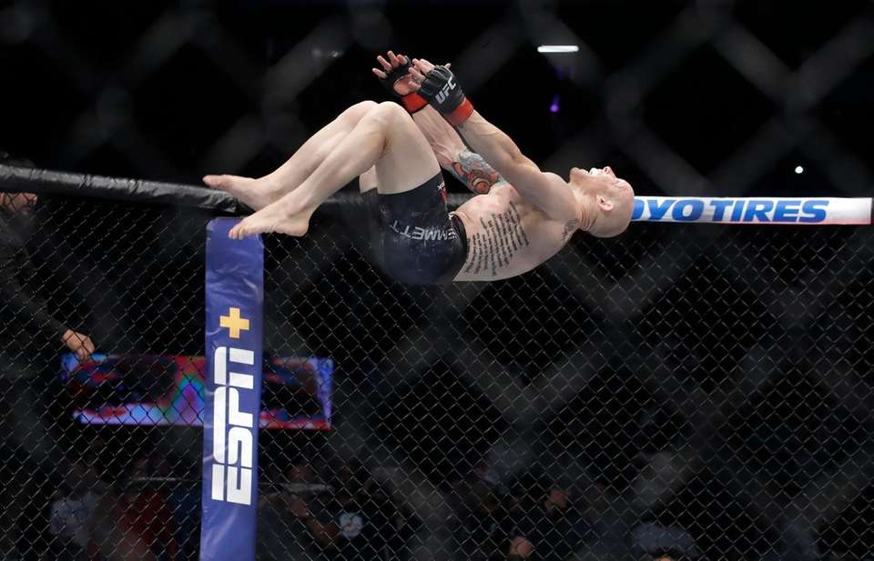 Josh Emmett does a back flip to celebrate
