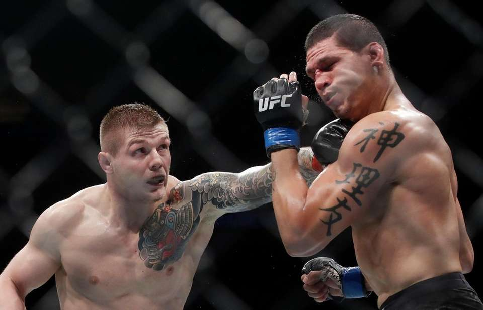 Marvin Vettori, left, punches Cezar Ferreira during a