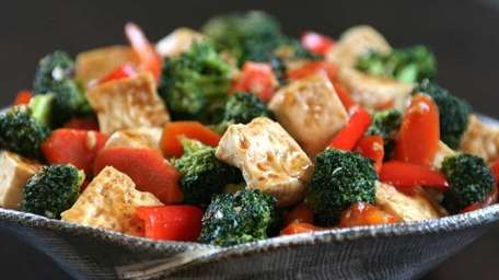 Tofu stir fry made with broccoli, carrots and