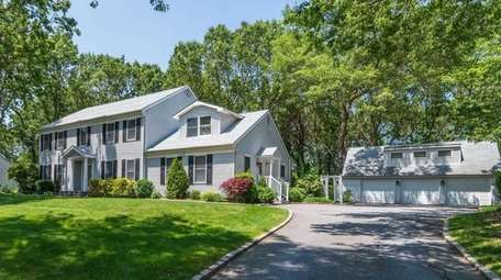 This Smithtown Colonial is listed for $829,000.