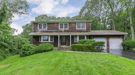 This Smithtown Colonial is listed for $589,000.