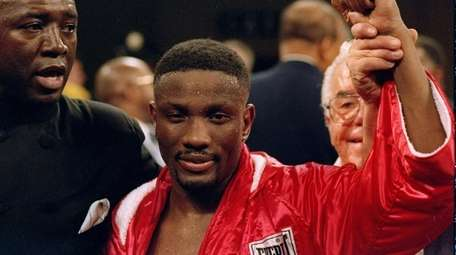 Pernell Whitaker stands in the ring before a