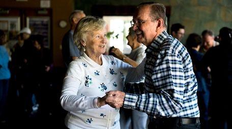 Anita Thomas, left, and her husband, Bill, dance