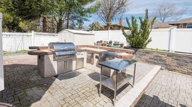 The outdoor kitchen at a Westbury home listed