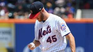 Mets starting pitcher Zack Wheeler reacts against the