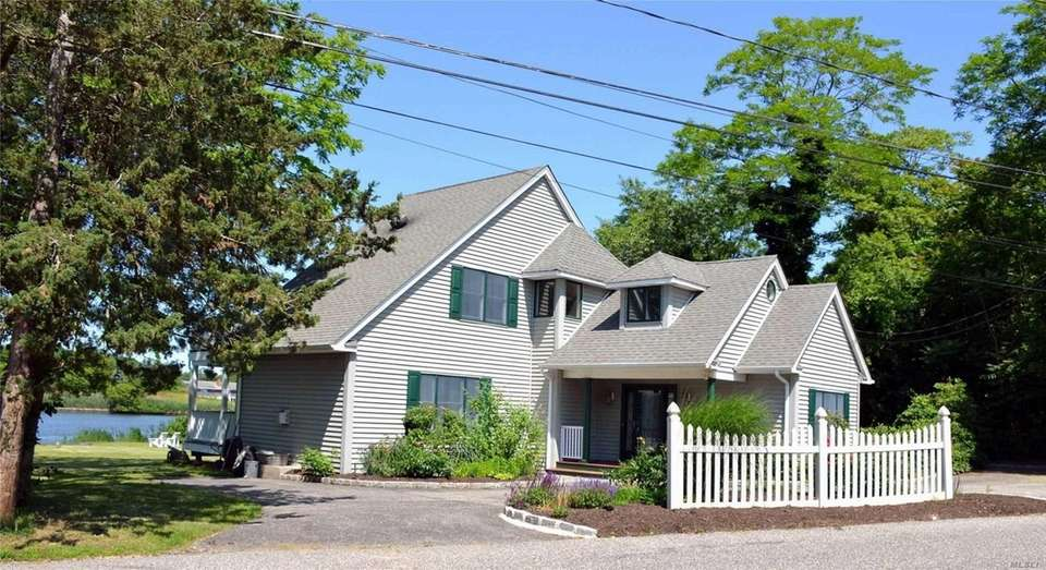 This Eastport traditional includes three bedrooms and two