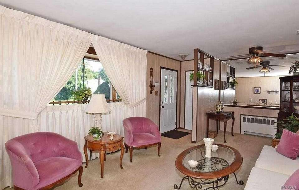 The house features a living room with a