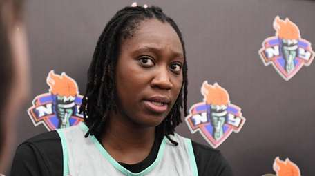 Tina Charles of the Liberty speaks during the