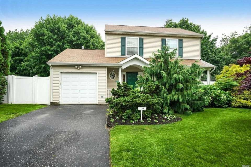 This Bellport Colonial includes three bedrooms and 1