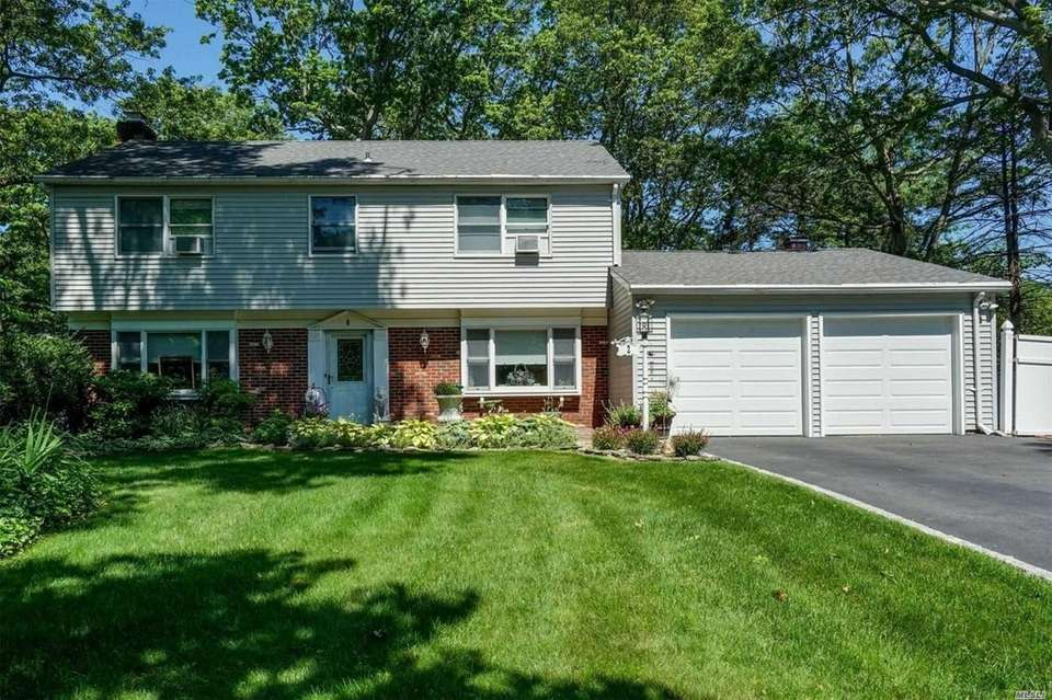 This Setauket Colonial includes four bedrooms and 3