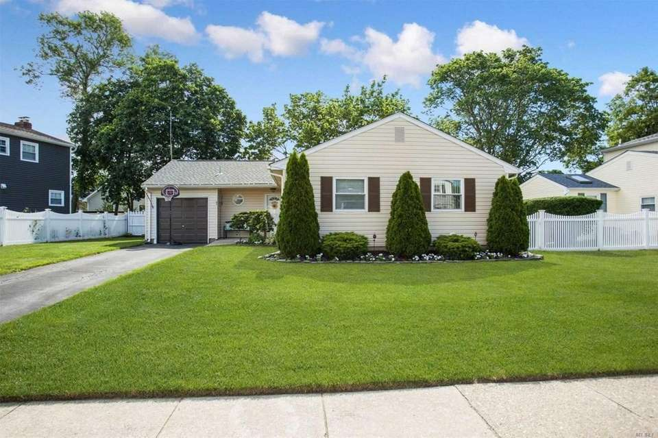 This Holbrook expanded ranch features three bedrooms and