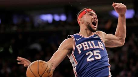 Philadelphia 76ers' Ben Simmons reacts after dunking during
