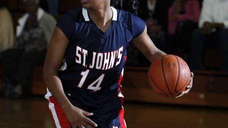 St. John's Brianna Thomas (14) looks to pass