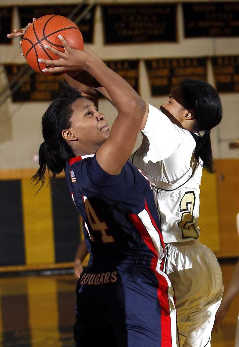St. John's Brianna Thomas (14) goes up for