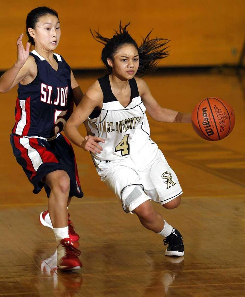St. Anthony's point guard Tyla Parham (4) drives