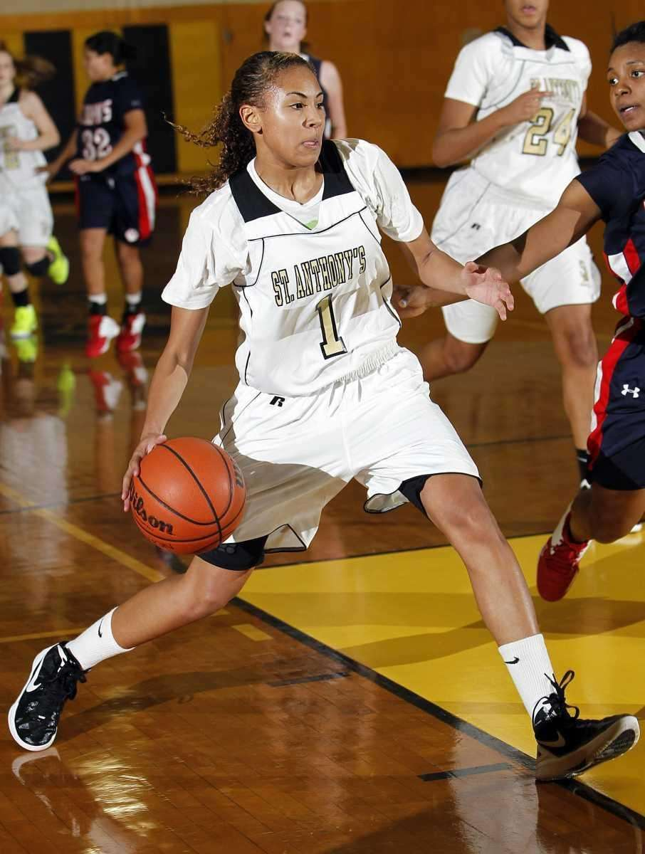 St. Anthony's Chastity Taylor (1) drives into the
