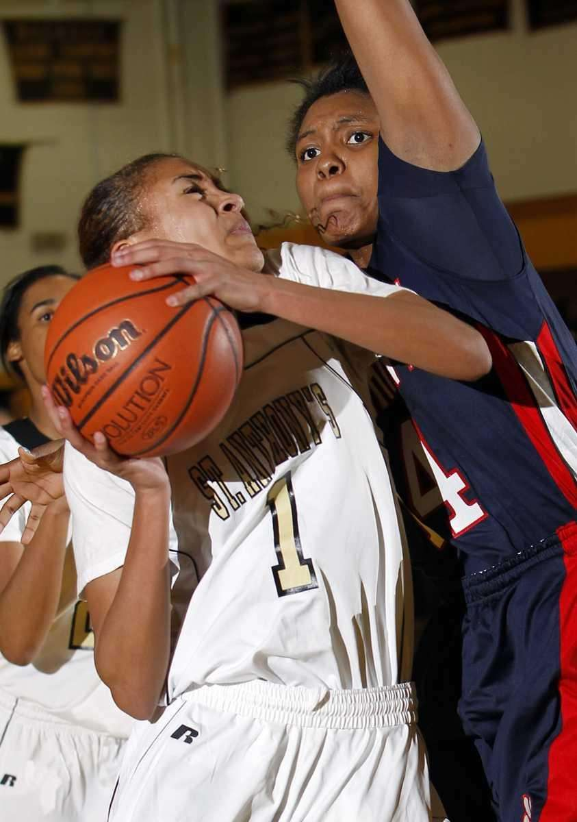 St. Anthony's Chastity Taylor (1) drives for the